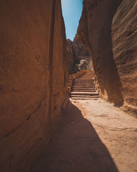 Direction Nature Architecture Ancient Civilization History Travel Arid Climate Mountain Travel Destinations Sunlight Outdoors Archeology Stairs Hike Petra Jordan Middle East Bedouin Desert Sunny Temple Tombstone Crazy Place Canyon Valley