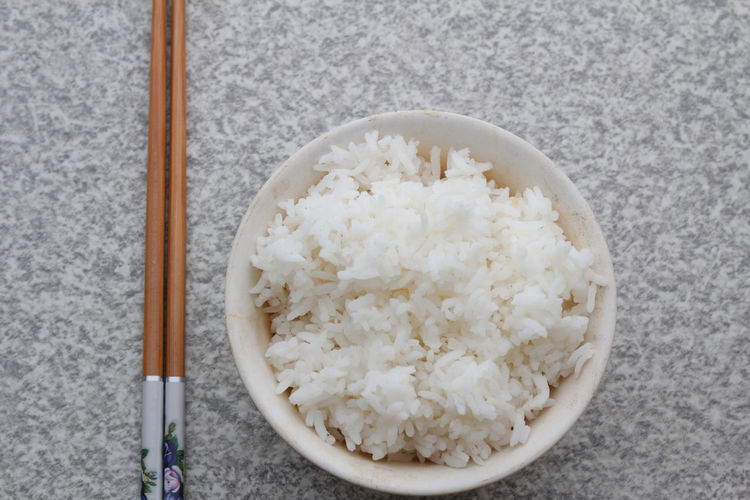 Directly above shot of rice and chopsticks