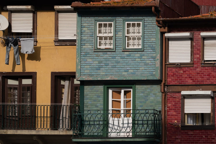 Architecture Window Built Structure Building Exterior Building Residential District No People Day House Outdoors Balcony Old Railing City Entrance Shutter Door Façade Low Angle View Brick Row House Apartment Red Green Yellow