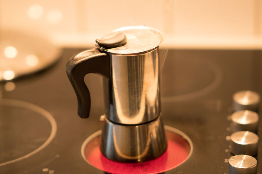 Coffee pot on electric stove. Domestic kitchen Breakfast Caffeine Coffee Coffee Time Espresso Moka Moka Pot Pouring Stove Weekend Bar Cafe Cafe Time Cafeteria Caffè Cappuccino Close-up Coffee Cup Domestic Kitchen Good Morning Indoors  Kitchen Leisure Restaurant Wake Up