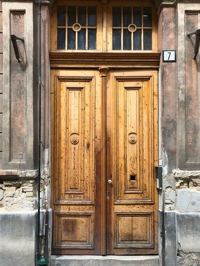 Huge old wooden door. Shabby chic vintage door on streets of Budapest. Faded glory, Brass Handle Huge Door Vintage Door Budapest Streetphotography EyeEm Selects Door Built Structure Entrance Architecture Closed Building Exterior Weathered Front Door Doorway Wood - Material Building No People House