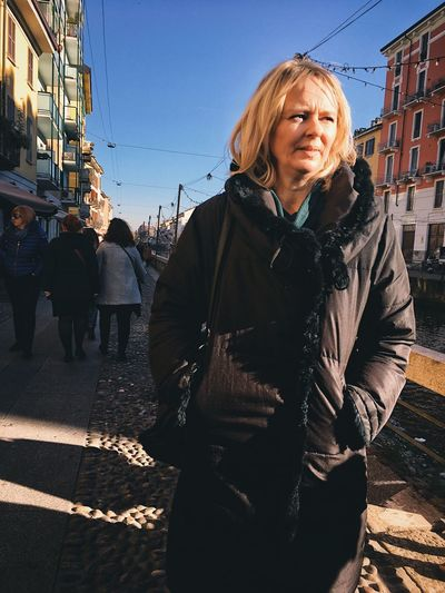 Portrait of mature woman in city