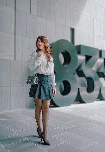 Office girl in cbd under office building