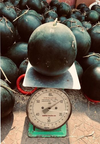 Weight Scale Heavy ShotOnIphone Fruit Weighing Scales Vietnam Ho Chi Minh City Watermelon Scale  No People Close-up Still Life Indoors  Table Shape Focus On Foreground Wellbeing High Angle View Sunlight Day Food Sphere Nature