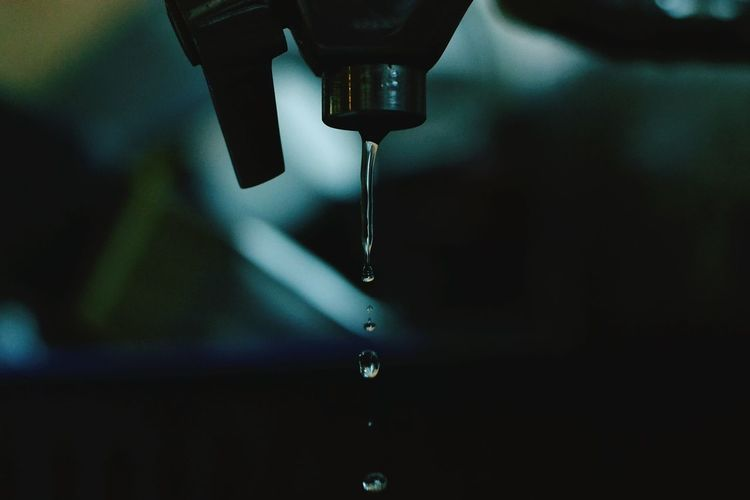 Close-Up Of Dripping Tap