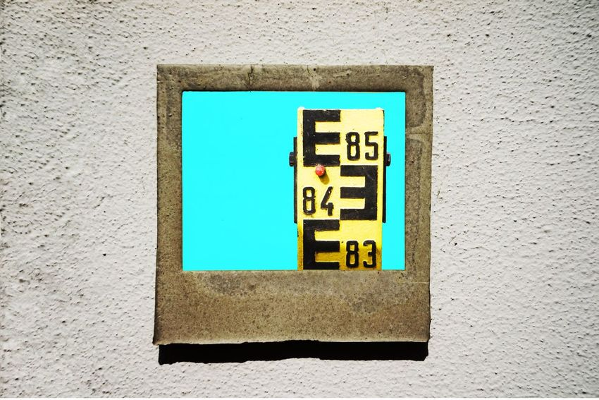 Frame Flood Marker Wall - Building Feature Built Structure No People Architecture Day Building Exterior Close-up Outdoors Wall Sunlight Blue Square Shape