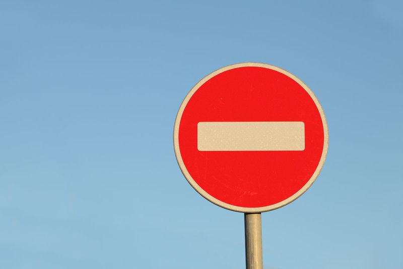 Road sign no entry on a blue background Sign Road Sign Blue Geometric Shape Circle Red Road Sky Communication Clear Sky Low Angle View Do Not Enter Sign Information Copy Space Information Sign