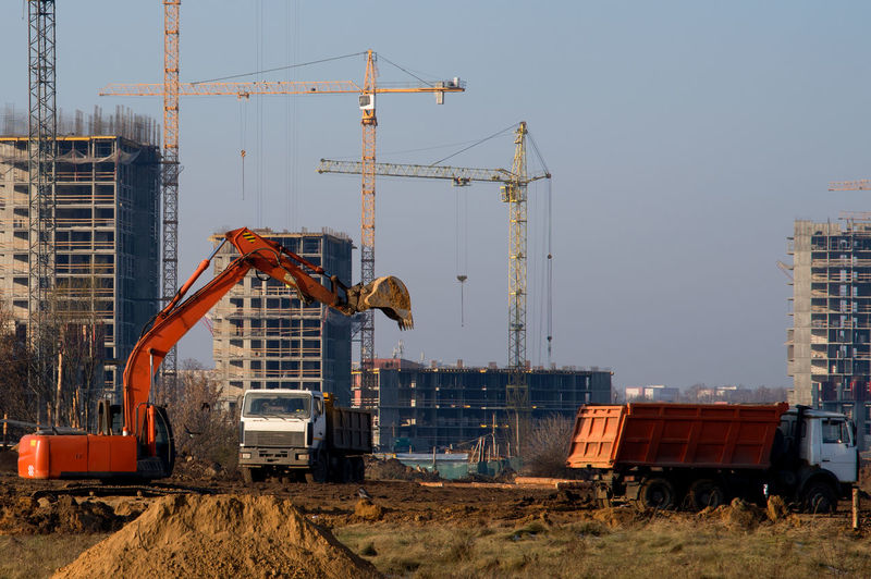 Crane at construction site against clear sky