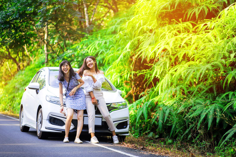 Vacation time in Khao Yai National Park Togetherness Two People Young Women Car Transportation Smiling Plant Tree Nature Outdoors Fern Leaf Nature Green Plant Garden Woman Girl Travel Beautiful Park Thai Woman Khao Yai National Park Big Mountain Happy Woman