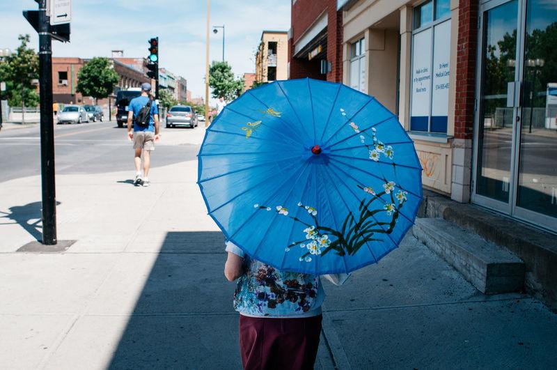 Man with umbrella on street