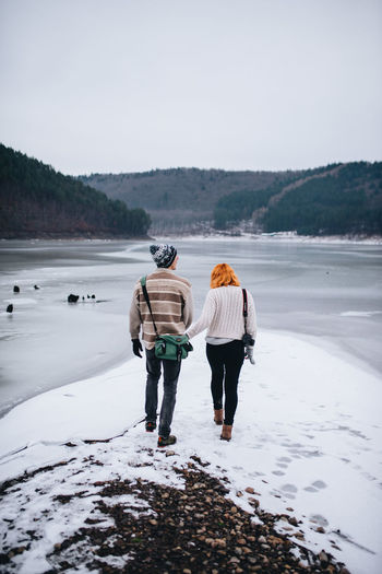 Snowy landscape with fog. Shot with Nikon d610 + Sigma 35mm 1.4 ART Location: Zetea Dam, Transylvania, Romani. Pele Photography 2017 Couple Photography Follow Me Transylvania Winter Portrait Couple Session Inlove Lake Side Orange Head Pele Photography Winter Couple Photography Winter Model