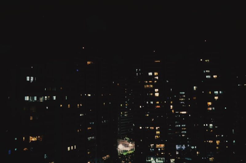 Cityscape against sky at night