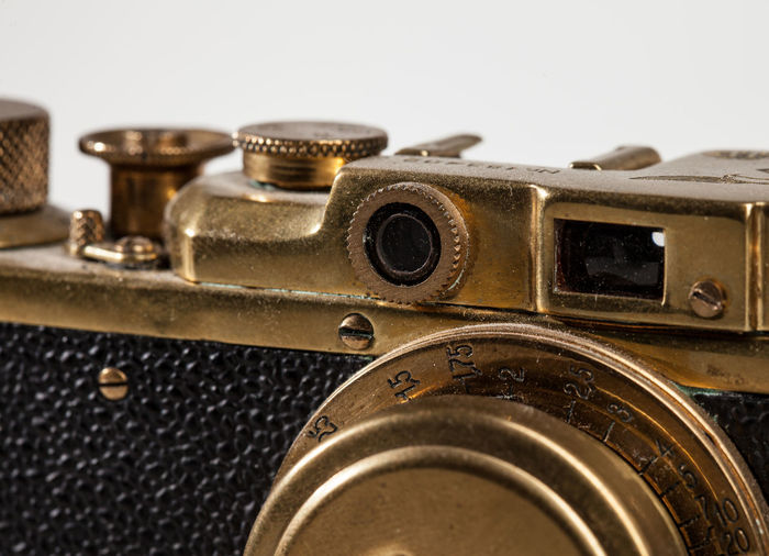 Antique Camera - Photographic Equipment Close-up Communication Electrical Equipment Equipment Gold Colored Indoors  Machinery Metal No People Obsolete Old Photography Themes Retro Styled Selective Focus Single Object Still Life Studio Shot Technology