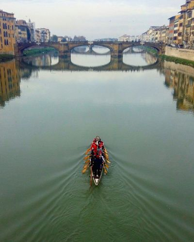 High Angle View Of People Rowing Boat In River Arno