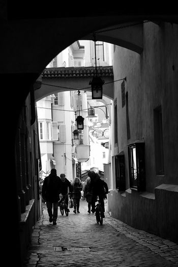 Street photography #Black&White #photostreet Architecture Building Exterior Built Structure Day Domestic Animals Full Length Leisure Activity Lifestyles Mammal Men Outdoors People Phtography Real People Rear View Togetherness Walking Women