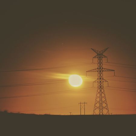 Electricity Pylon Sun Electricity  Sunpower Electricity  Light Sunrise Green Technology Green Power Going Green Enviromental Issue Nature No People Sunset Silhouette Beauty In Nature Outdoors Technology Sky