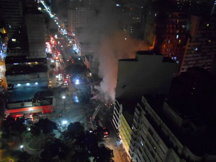 Building Collapse: Inner City Calamity in downtown São Paulo at Largo do Paissandú; 3 am May 1, 2018. The abandoned former Federal Police steel and glass skyscraper, which had been invaded by street people, imploded this early morning and the neighboring building has caught on fire as well. This photo taken about 4 am, May 1, 2018 at Largo do Paissandú. Destruction Largo Do Paissandu May 1, 2018 New On Eyeem Night Photography Susan A. Case Sabir The Week on EyeEm Unretouched Photography About 4 Am Building Collapse Building Fire Building Implosion Burning Building Controlled Chaos Dangerous Situation Downtown São Paulo High Angle View Implosion Responsiveness Smoke - Physical Structure Unexpected Event Urban Photography Urban Strife