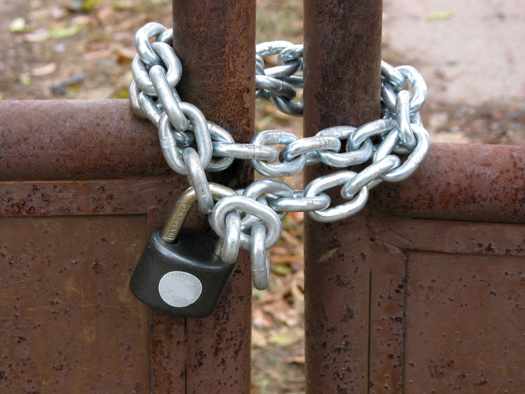Close-up of the chain and lock on old rusty gates. Chain Close-up Day Gates Lock Locked Door Locked Gates Metal No People Old Outdoors Rusty