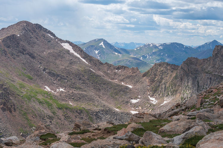 Landscape of bare mountain peaks with a bit of snow on mount evans in colorado