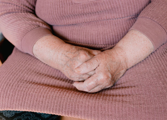 Midsection of woman holding hands