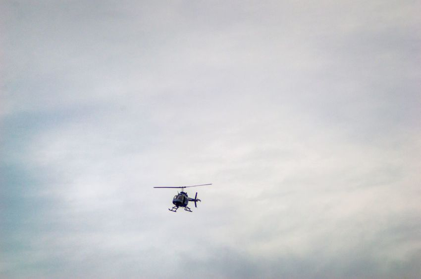 Flying helicopter on a cloudy afternoon Midflight Clouds Lovers Cloudy Sky Flying Helicopter Helicopter Photography EyeEm Selects Air Vehicle Mode Of Transportation Transportation Sky Cloud - Sky Flying Mid-air Plane on the move Helicopter Motion