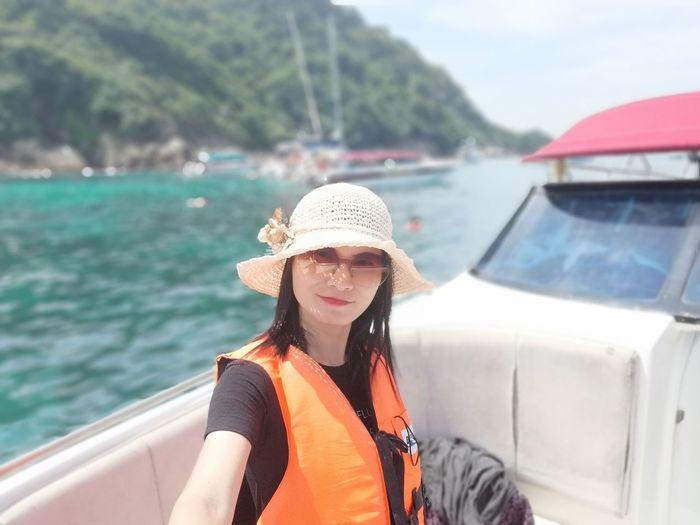 Portrait of woman on boat in sea