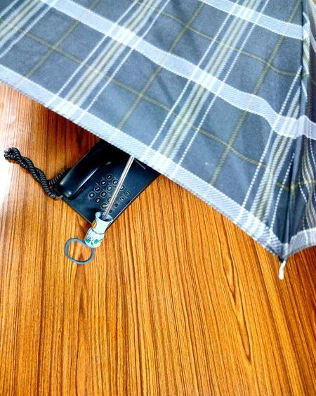 Phone under umbrella Pattern Design Umbrella Landline Table Wired Spiral Ssclix SSClicks SSClickPics SSClickpix Mobilephotography EyeEm Selects Low Section Close-up Textured