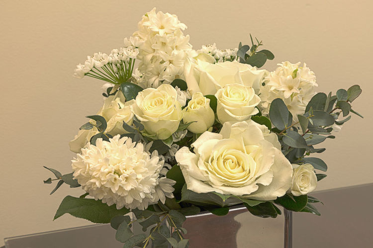 White wedding bouquet of flowers including roses, white lilac, hydrangea, star of David and hyacinth in a reflective mirror vase. Decor Hydrangea Star Of David Wedding Wedding Flowers White Roses Background Bouquet Bouquet Of Flowers Decoration Flower Arangement Flowers Hyacinth Rose - Flower Vase Of Flowers White Flower White Lilac