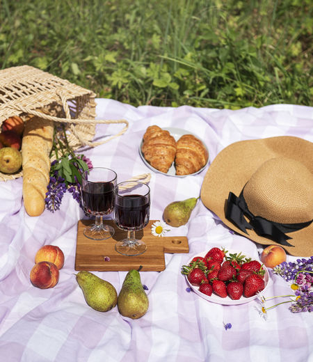 Various fruits in basket on table