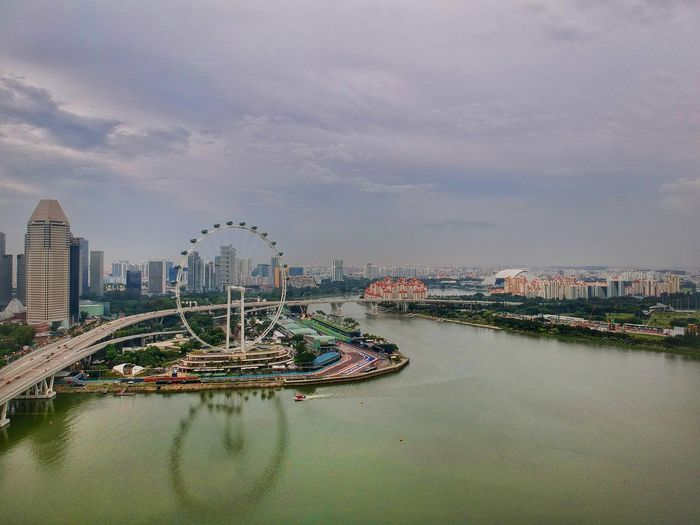 EyeEm Selects Singapore Singapore View Singapore Flyer City Cityscape Water Skyscraper Urban Skyline Sea Business Finance And Industry Sky Architecture Building Exterior Ferris Wheel Big Wheel Harbor