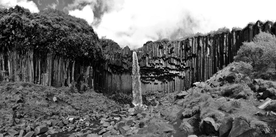 Beautiful icelandic scenery in black and white! Dark Iceland Beauty In Nature Blackandwhite Cave Darkness And Light Day Mountain Nature No People Outdoors Physical Geography Rock - Object Rock Formation Scenics Sky Svartifoss Tranquility Waterfall