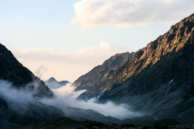Scenic view of pyrenees against sky during foggy weather