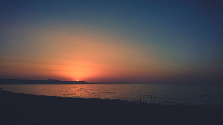 Sea Horizon Over Water Tranquility Tranquil Scene Sunset Water Beach Scenics Beauty In Nature Travel Destinations Outdoors No People Multi Colored Nature Silhouette Sky Summer Tourism Landscape Sun Tranquility Beauty In Nature