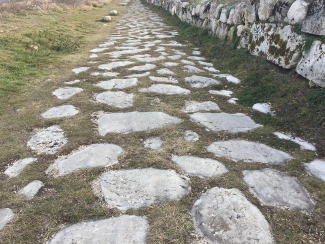 Massa d'Albe, Italy - December 26, 2017: Alba Fucens Roman remains. Ancient Italic town occupying a lofty location (1,000 m) at the foot of the Monte Velino, north of Avezzano, Abruzzo Abruzzo Ancient Archaelogical Excavations Archaeological Site Archaeology ArcheologicSite Archeology Architecture Italia Remains Ruins Tradition Alba Fucens Archaeological Archaeological Sites Archeological Complex Archeological Site Archeologie Column Culture Historic History Italian Italy Old An Eye For Travel