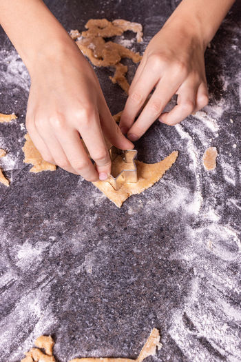 Midsection of woman preparing cookies