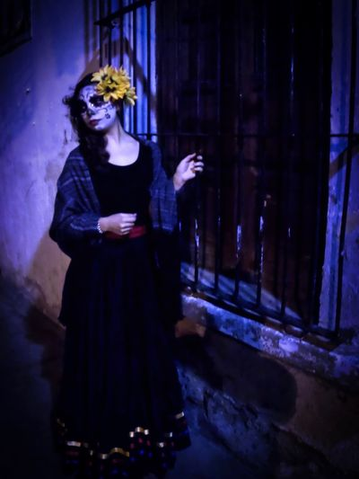 Catrina looking away Catrina Catrina Day Of The Dead DIA DE MUERTOS Real People One Person Night Young Adult Leisure Activity Lifestyles Young Women Women Clothing Architecture Standing Built Structure Fashion Building Exterior Illuminated Front View Adult Holding Beautiful Woman