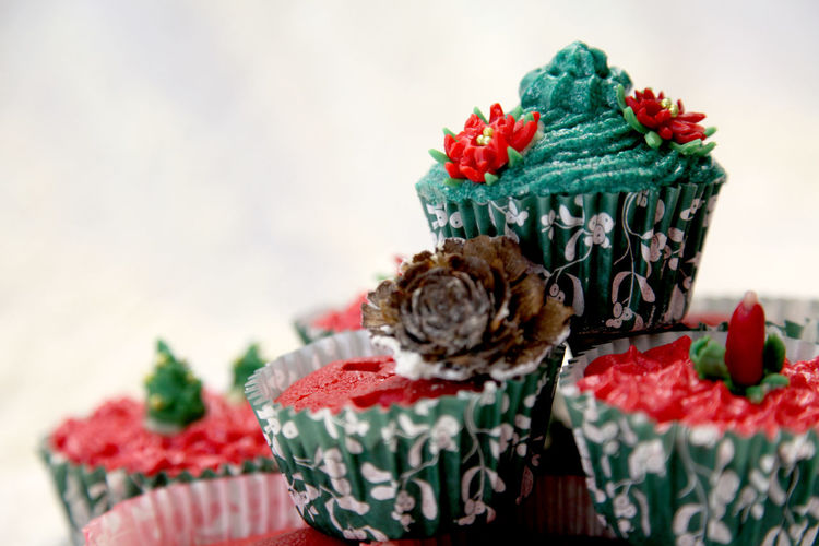 Close-Up Of Christmas Cupcakes Against White Background