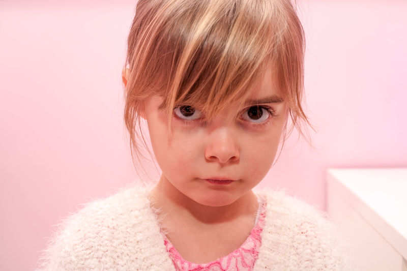 Cute little girl looking sad. Attractive preschooler kid with angry expression. Pretty female child upset face. Model release. Authentic childhood concept. Anger Angry Beautiful Blonde Center Childhood Close-up Cute Depressed Full Frame Girl Headshot Human Face Innocence Kid Lifestyles Model Person Pink Portrait Preschooler Sad Sad Face Stress Studio Shot The Portraitist - 2017 EyeEm Awards