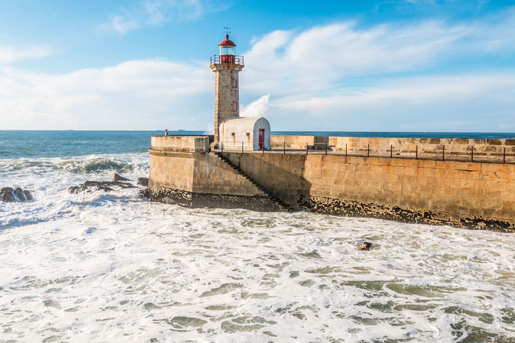 Felgeiras Lighthouse and Pier in Porto Architecture Building Exterior Built Structure Cloud - Sky Day Felgeiras Felgeiras Light Guidance Horizon Over Water Light Lighthouse Nature No People Porto Porto Portugal Porto Portugal 🇵🇹 Power In Nature Sea Sky Surf Tower Travel Destinations Water Waterfront Wave