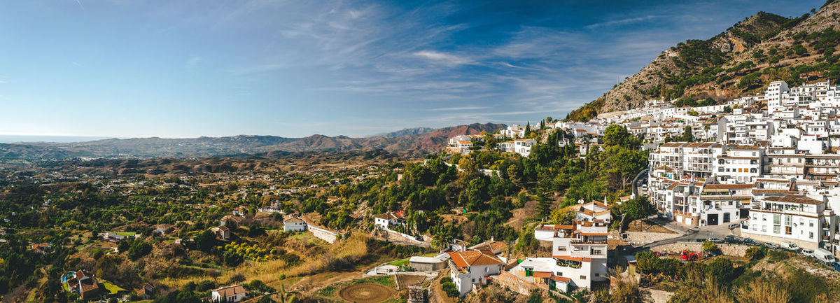 Panorama of white village of Mijas. Costa del Sol, Andalusia. Spain Andalucía Benalmádena, Malaga, Spain Costa Del Sol Europe High Angle View Hillside Houses Landmark Landscape Malaga Mijas Mountain Panorama Panoramic Residential Building Rofftop SPAIN Spanish Town TOWNSCAPE Travel Destinations View Village White Houses Whitewashed Houses