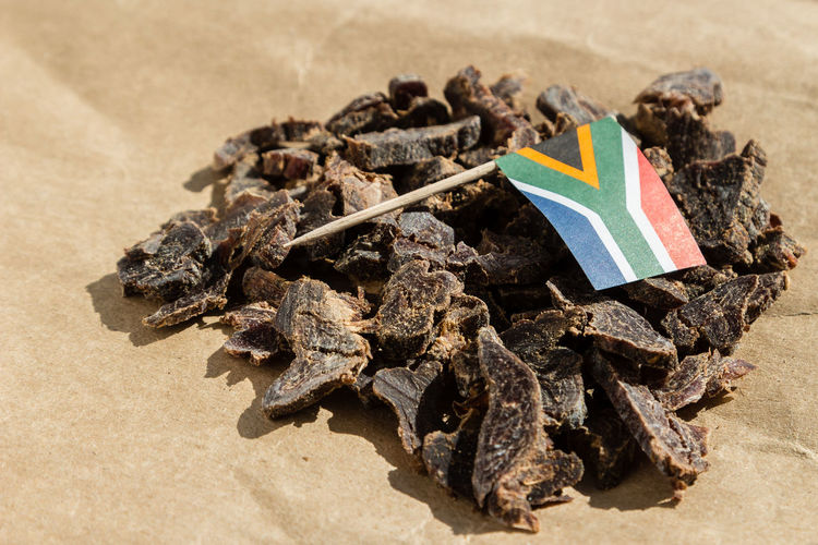 South African biltong (dried meat) on brown paper Delicious ♡ Jerky  Snack South Africa Beef Jerky Biltong Brown Culture Cured Meat Dried Meat Exotic Food Flag Food High Angle View Meat No People Paper Protein Snack Salty Tasty Toothpicks