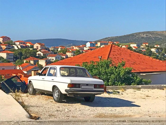 White vintage car by croatian village Landscape View Cool Vibe Balcan Editerranean Seaside Sea Rooftop Croatia Classic Retro Automobile Vintage Old Clear Sky Car House Day Architecture Outdoors Sunlight Blue Built Structure Transportation No People Mountain Nature Sky