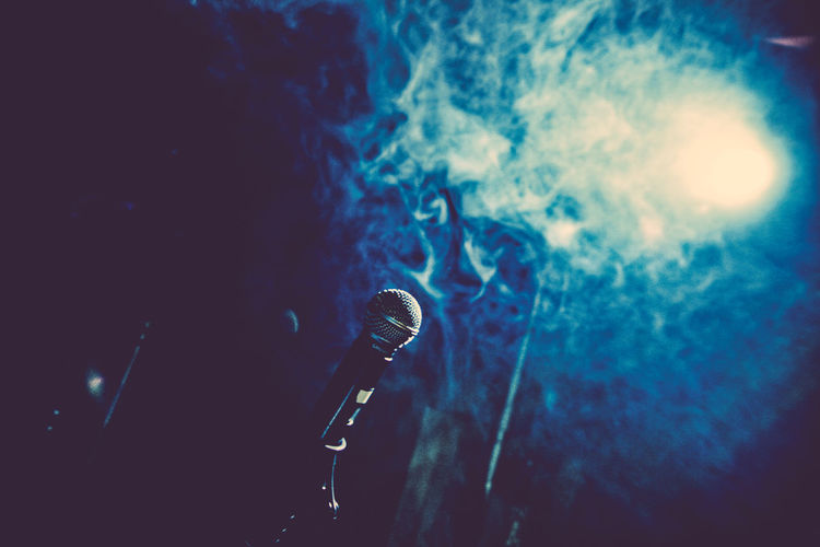 Arts Culture And Entertainment Atmospheric Mood Blue Concert Concert Photography Event Glowing Live Music Microphone Music Musician On Stage Smoky