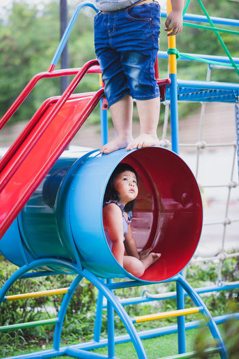 Kids playing on play equipment at park