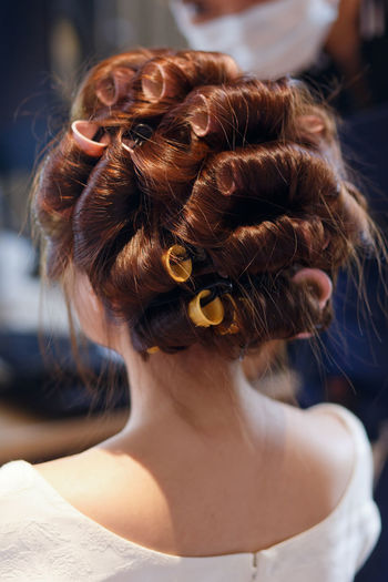 Rear view of a woman in a hair salon Hairstyle One Person Hair Headshot Real People Hair Bun Women Adult Portrait Focus On Foreground Lifestyles Rear View Close-up Brown Hair Human Hair Bride Indoors  Leisure Activity Wedding Beautiful Woman Hair Salon Comb Curly Hair Professional Occupation Fashion