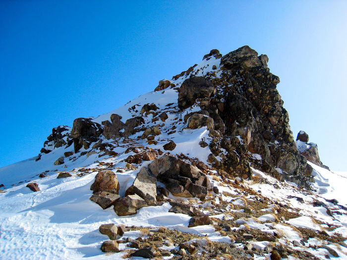 Rocky mountain with snow Cold Temperature Rock Scenics - Nature Tranquil Scene Solid Day No People Mountain Rock Formation Non-urban Scene Nature Tranquility Clear Sky Winter Blue Sky View Scenery Adventure Outdoors Sunny Trip Crags Mountain Climbing Stone Snow