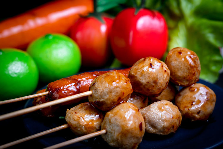 Close-up of fresh vegetables on barbecue grill