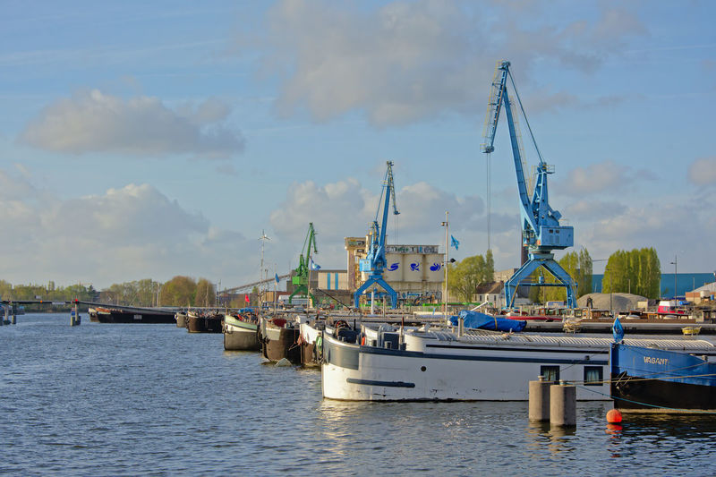 Download Gent Harbor With Cranes And Living Boats Editorial Stock Image - Image: 90223199 `Dok Noord` harbor along river Scheltd in Ghent, Flanders with blue industrial cranes and living boats Dok Noord Ghent Boat Ride Crane - Construction Machinery Dok Noord Gent Harbor Harbottle Crag Living Boat Mode Of Transport Moored Nautical Vessel Scheldt Ship Transportation Water Waterfront