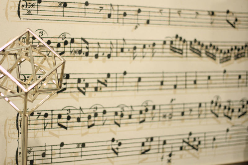 High angle view of music notes on paper