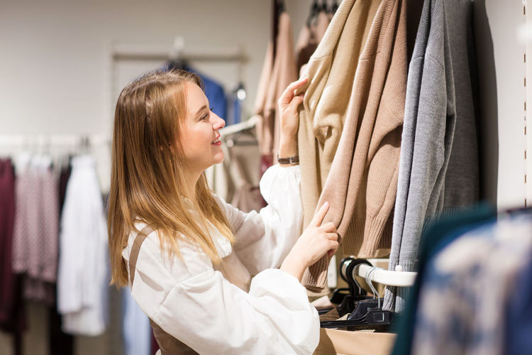 Midsection of woman in rack at store